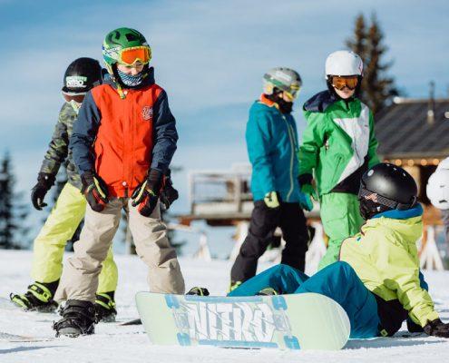 Lerne Snowboarden beim Wild East Snowboardkurs & Kidscamp